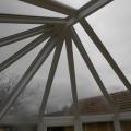 Télikert alakos üveg tető